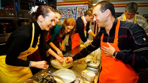 Group enjoying their time cooking food at the Hungarian Cooking Class in Budapest