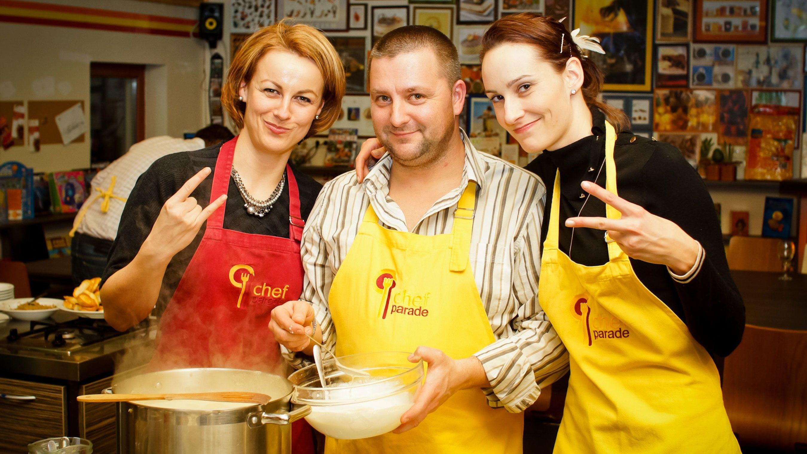 Group smiling for the camera as they are cooking at the Hungarian Cooking Class in Budapest