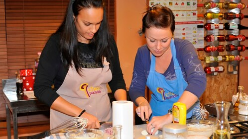 Two young ladies preparing to make a meal at the Hungarian Cooking Class in Budapest