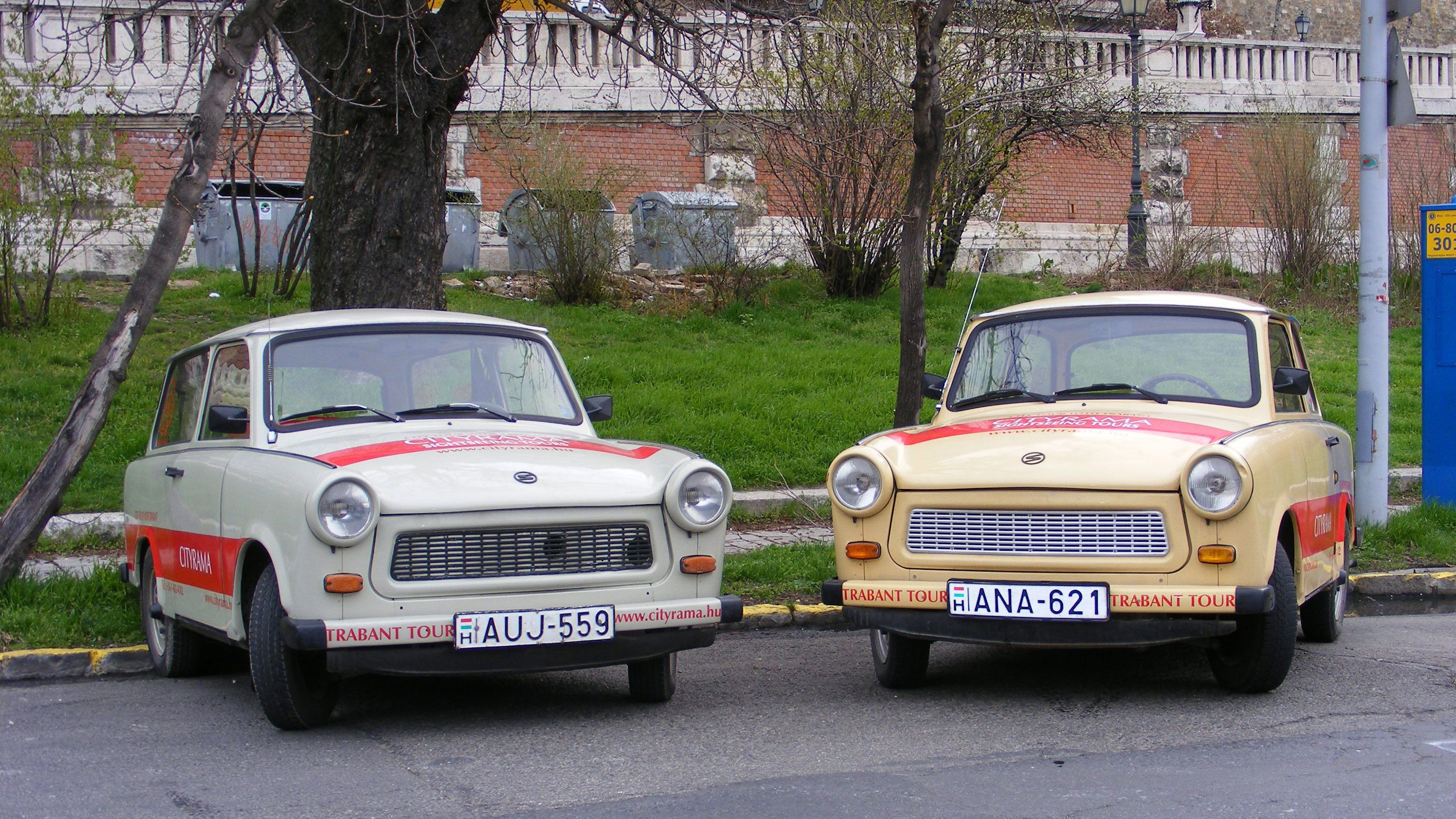 Two parked Trabant Cars parked on the side of the road in Budapest