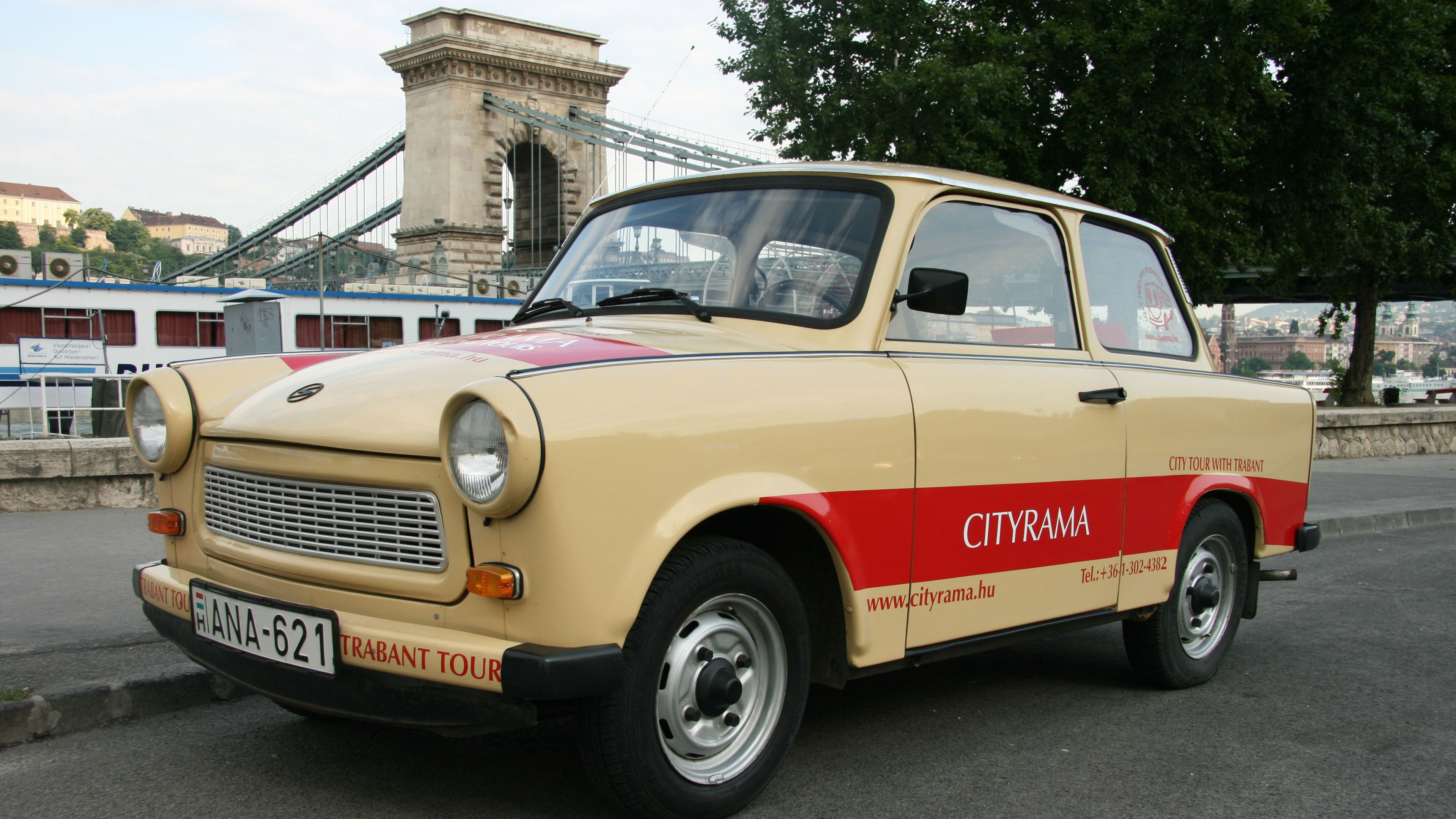 A Trabant Car parked on the side of the road in Budapest