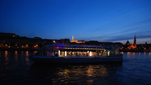 Gorgeous view of the boat sailing on the Danube at night