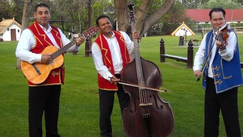Men playing guitar violin and cello in Lajosmizse