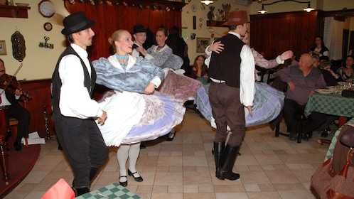Couples dancing at the Hungarian Folklore Show in Budapest