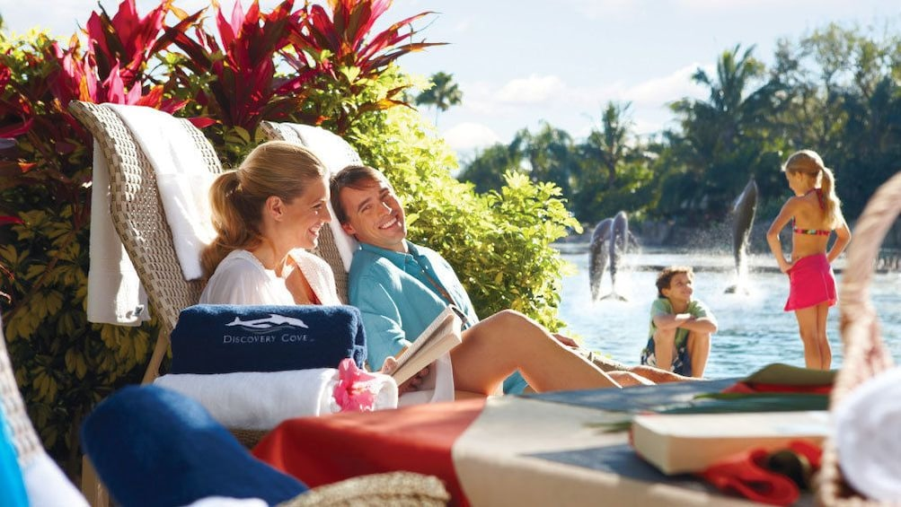 Lounging couple by the pool in Orlando.