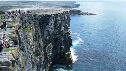 Sitting on the steep cliffs in Ireland