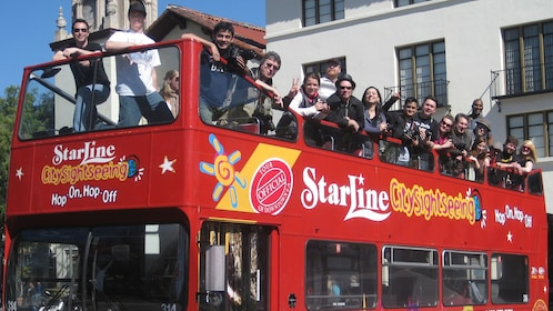 Double decker tour bus full of people in Los Angeles.