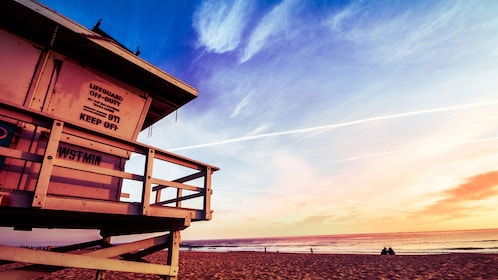 Lifegaurd stand on a Los Angeles beach at sunset.