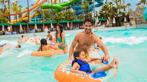 Family plays in a wave pool in Knott's Berry Farm Soak City