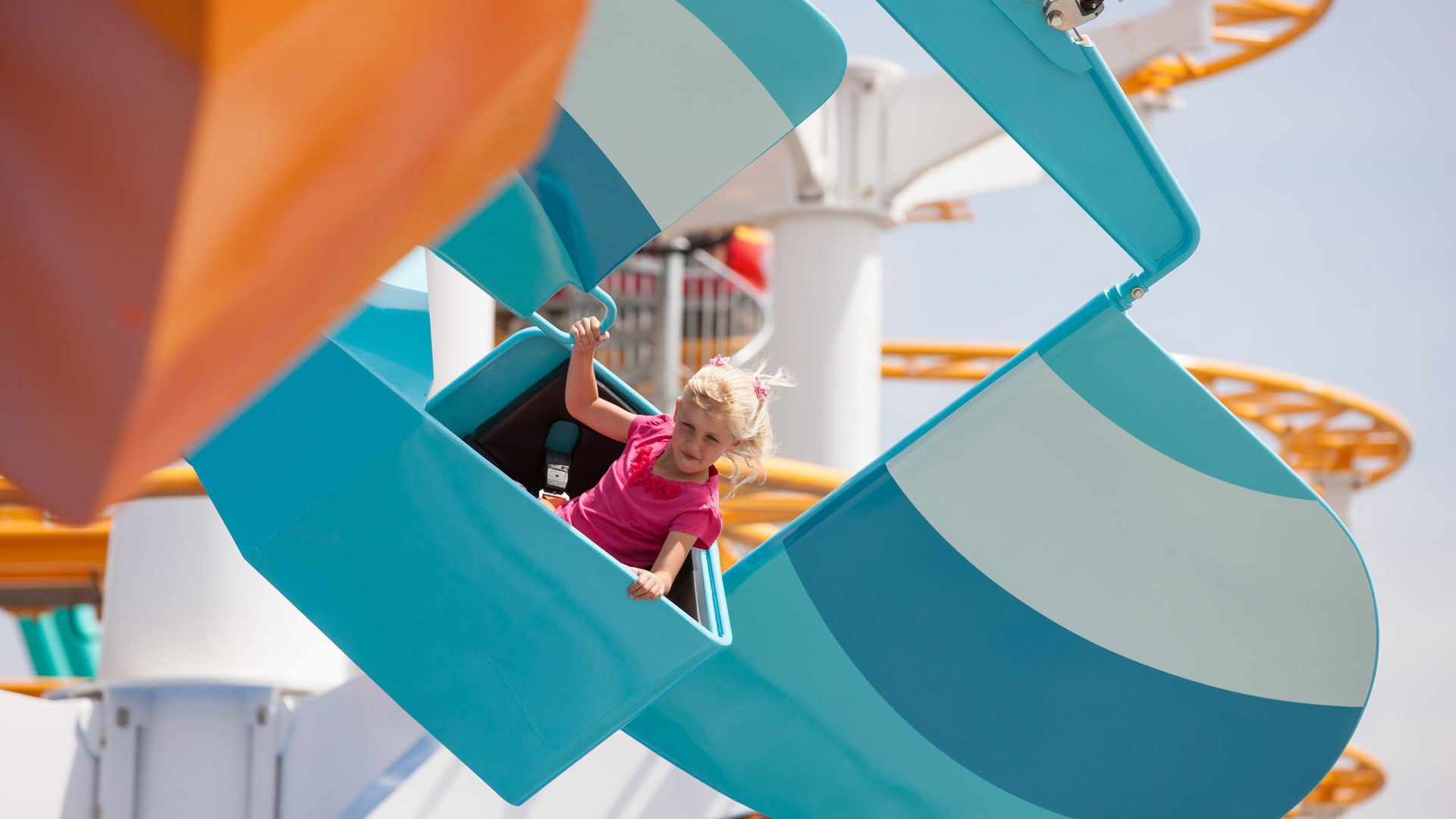 Young girl enjoying a ride at Knott's theme park in California.