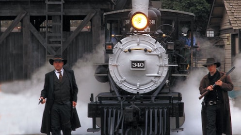 Two western gunslingers guarding a train at Knotts Berry Farm theme park in California.