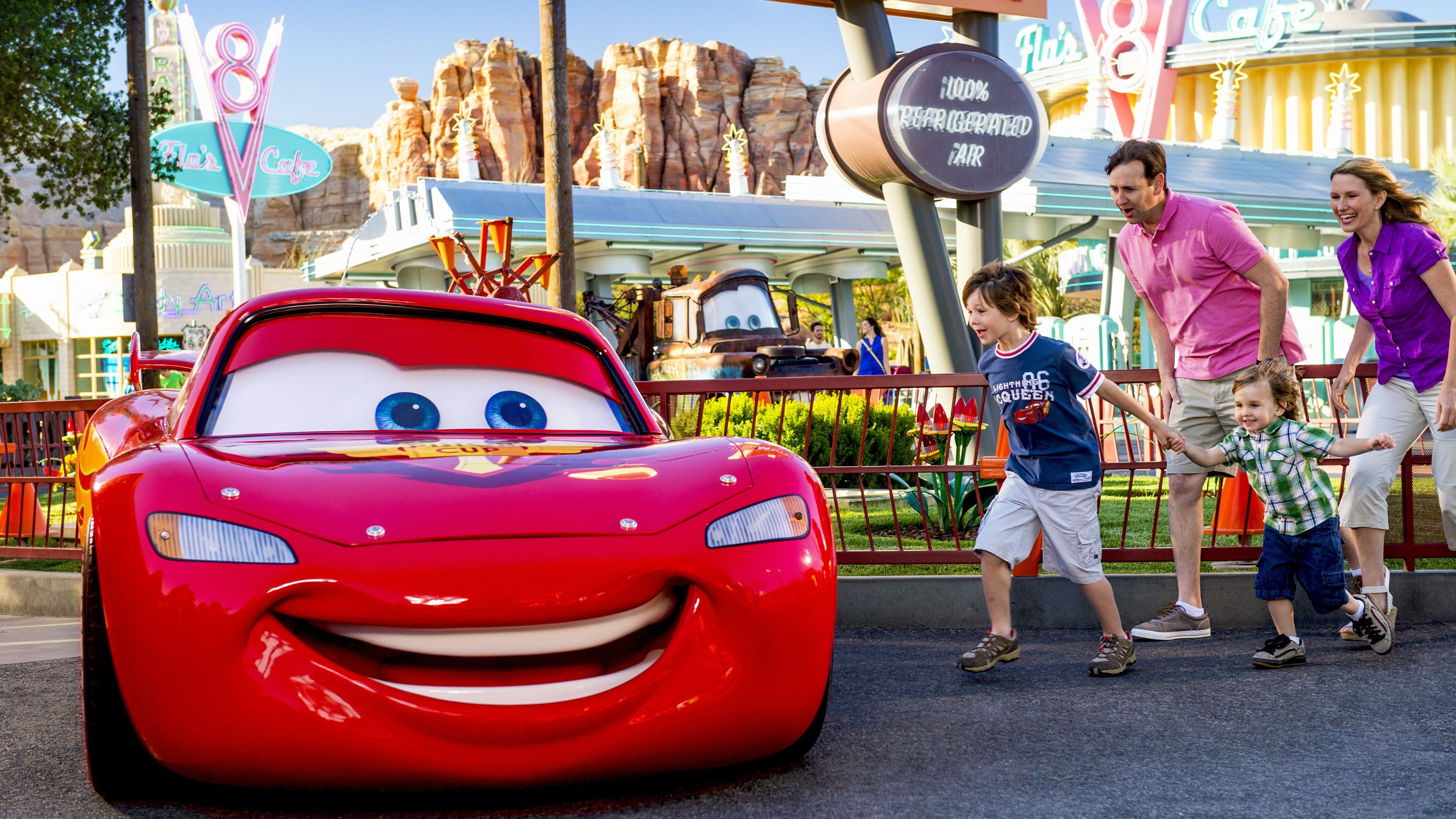 Lightning McQueen and a family in Radiator Springs, Disneyland