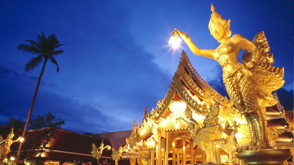 golden ornamented building at the FantaSea Cultural Theme Park in Thailand