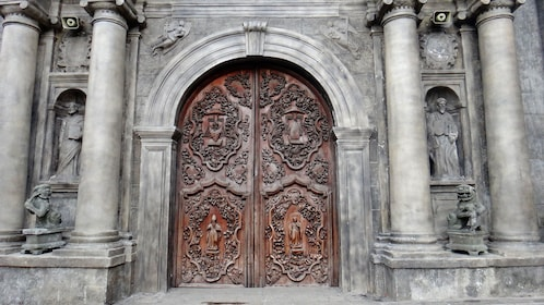 View of large carved doors of cathedral in Manila
