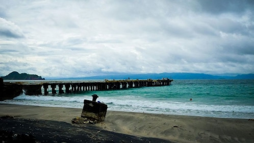 Long pier and sandy beach on the coast of Corregidor Island