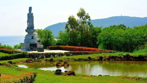 Large monument and colorful gardens surrounding a pond on Corregidor Island