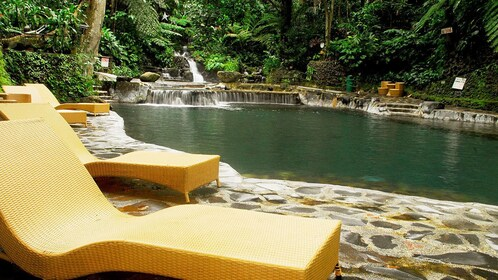 Chaise lounges along the hot spring pool at Hidden Valley Resort