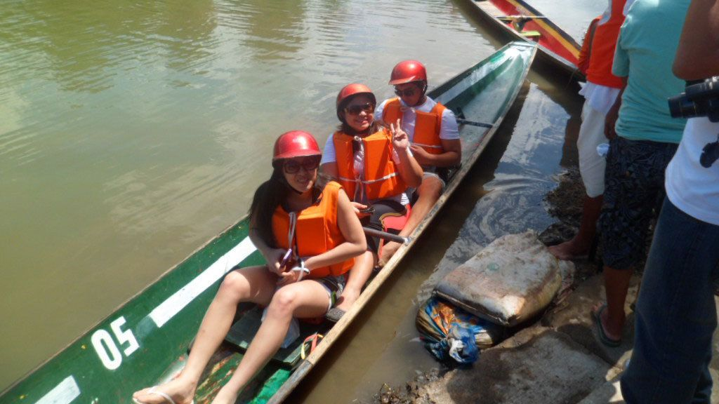 Group in a canoe on the river in Pagsanjan