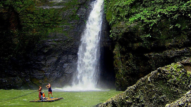 Bamboo raft near Pagsanjan Falls with Devil's cave behind