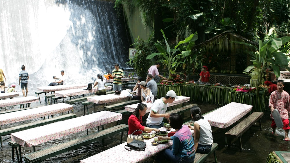 Show item 3 of 6. People enjoying buffet in waterfall in Manila