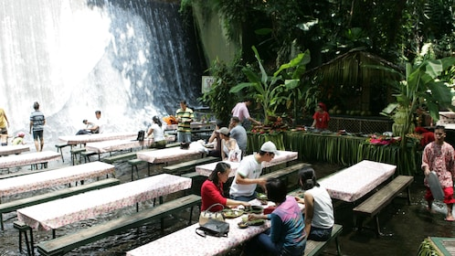 People enjoying buffet in waterfall in Manila