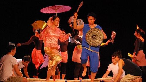 Elaborate performance involving fans, umbrellas and a sword in Manila