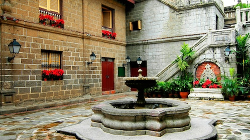Fountain in a stone courtyard in Manila