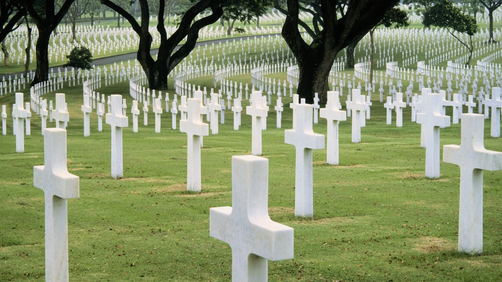 Show item 3 of 7. Rows of crosses marking the graves at American Cemetery in Manila