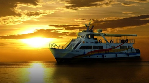 Cruise ship on water at sunset off the coast of Manila