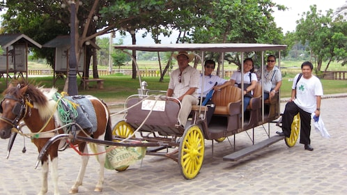 Las Casas Filipinas Resort guests in a horse-drawn carriage in Manila