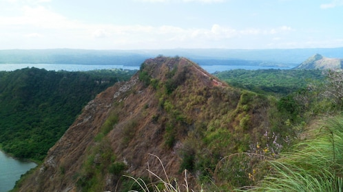 Tree covered cliffs along the edge of the Taal Volcano in Manila