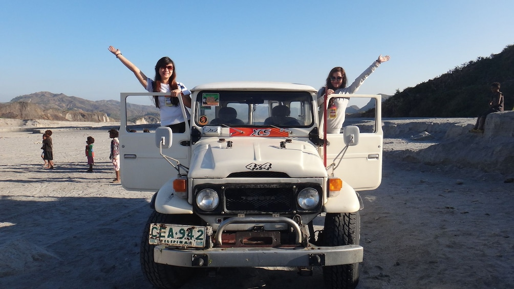 Show item 1 of 7. Pair of young women in a jeep in the Philippines