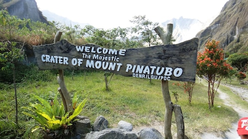 Wooden sign marking the crater of Mount Pinatubo