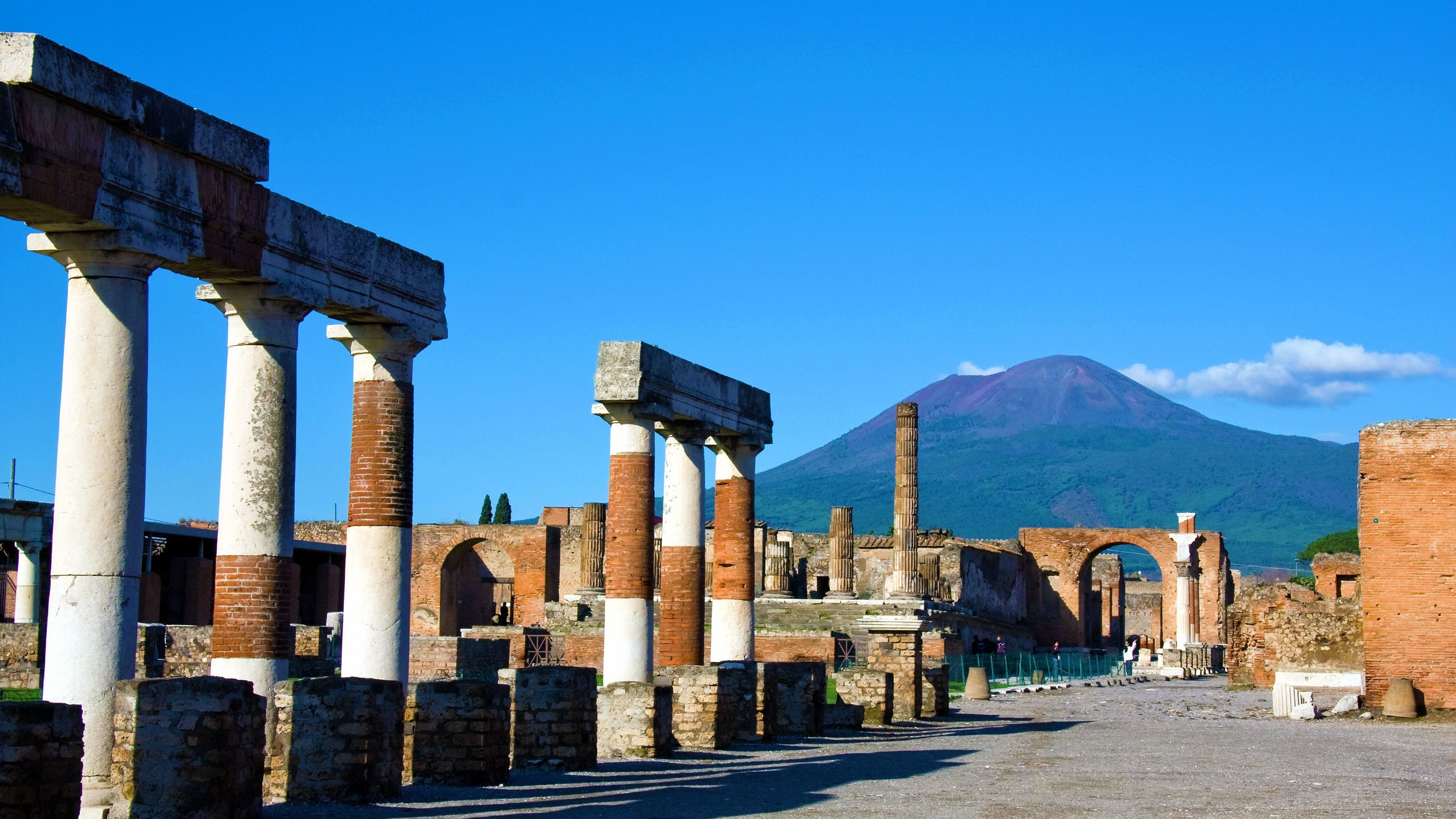 Ruins of the Temple of Jupiter with Mount Vesuvius in the background in Pompeii