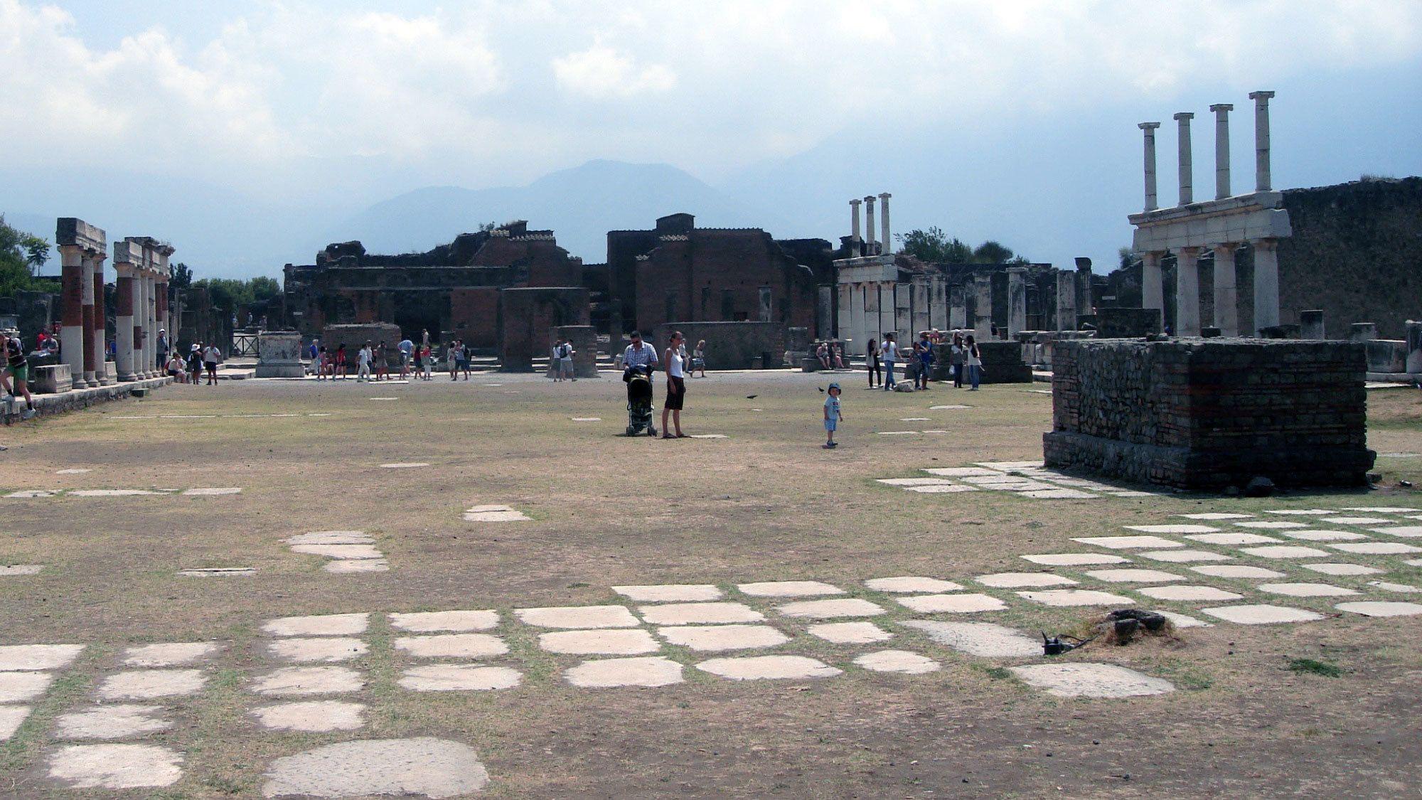 People walking among the ruins of Pompeii