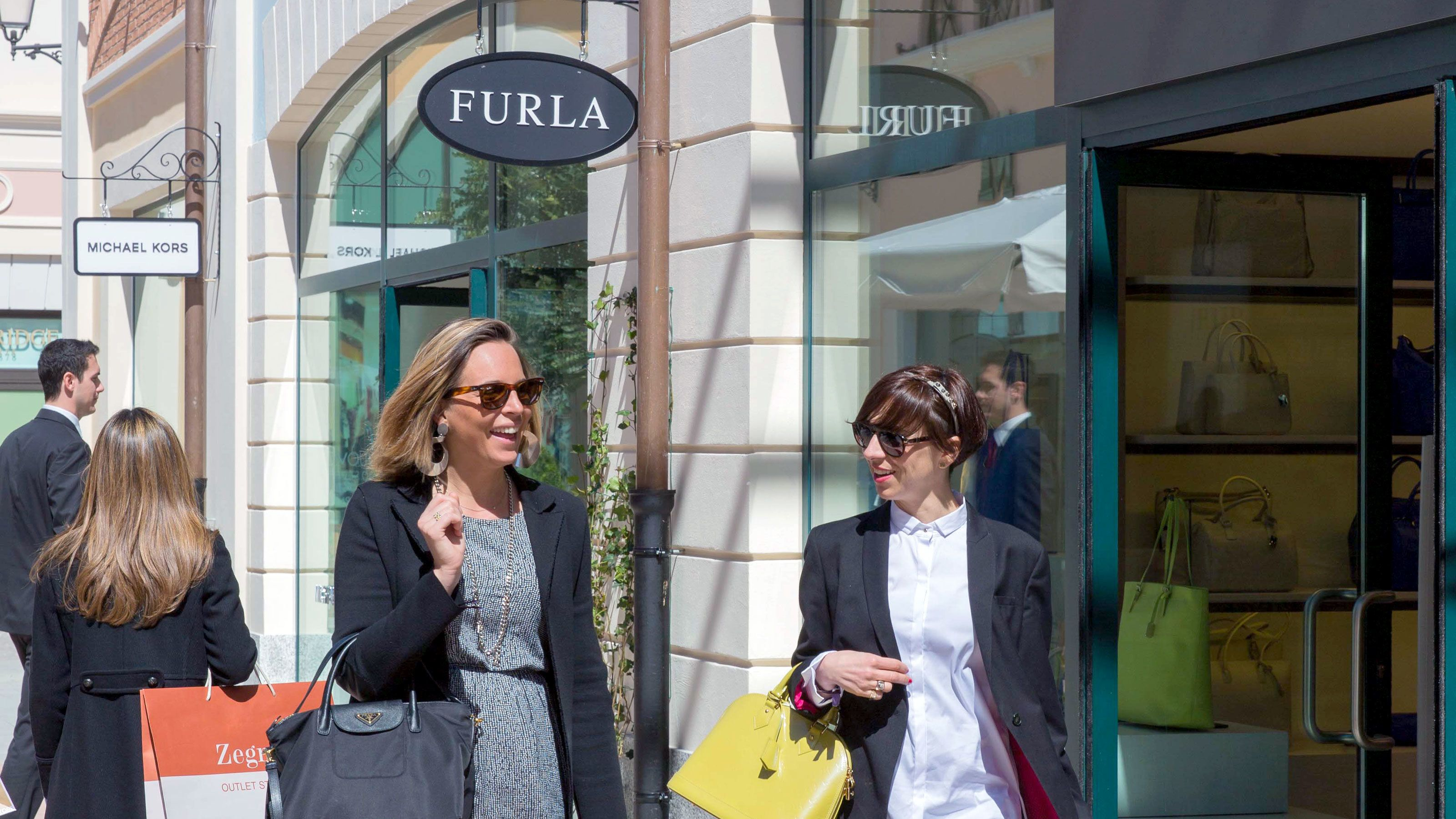 Women shopping at FoxTown near Milan