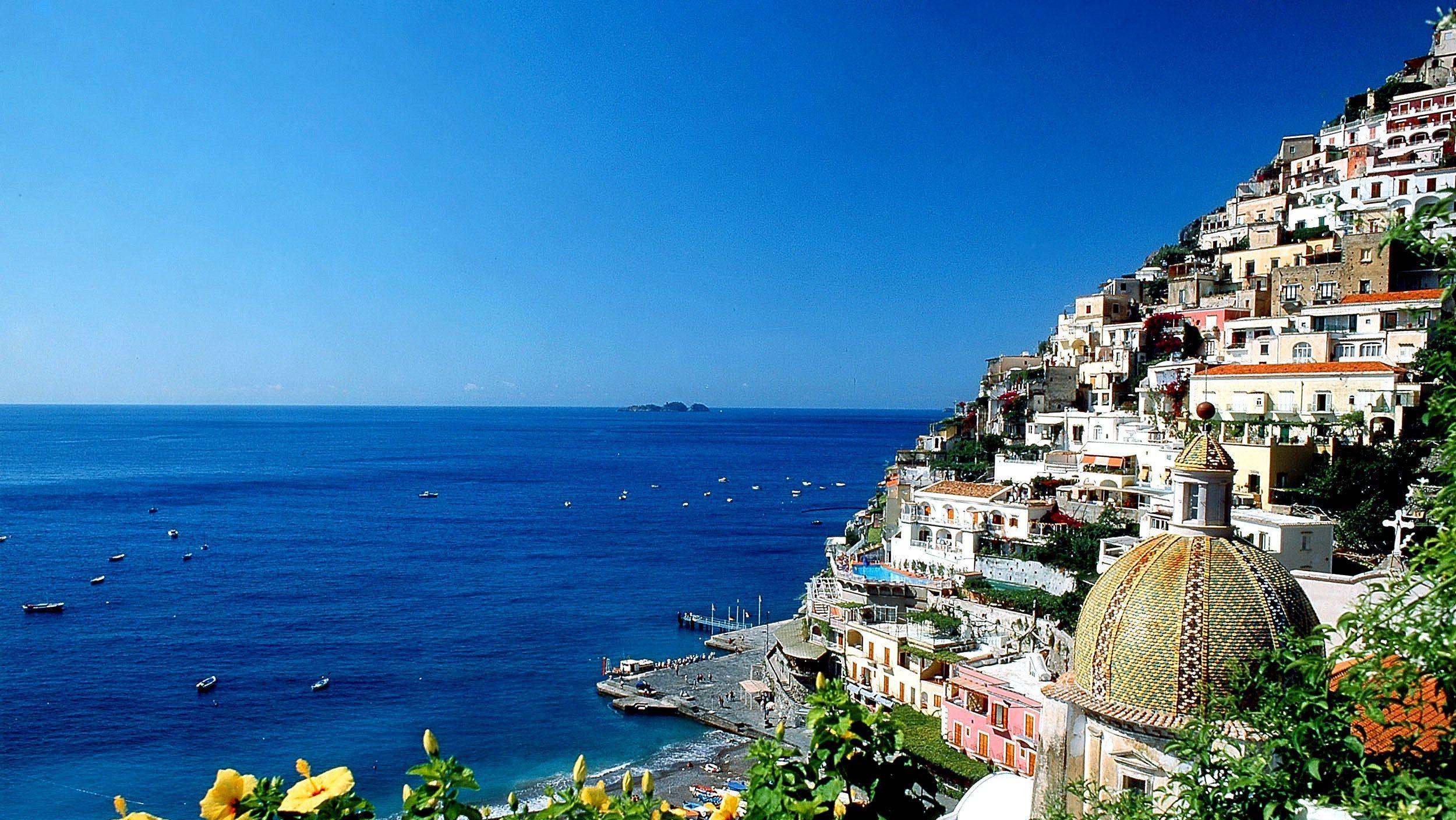 Peering past buildings at the Amalfi coast