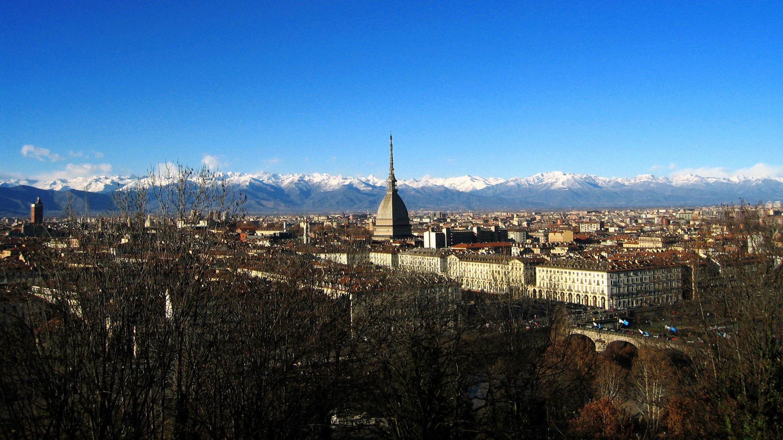 View of the city of Turin surrounded by mountains