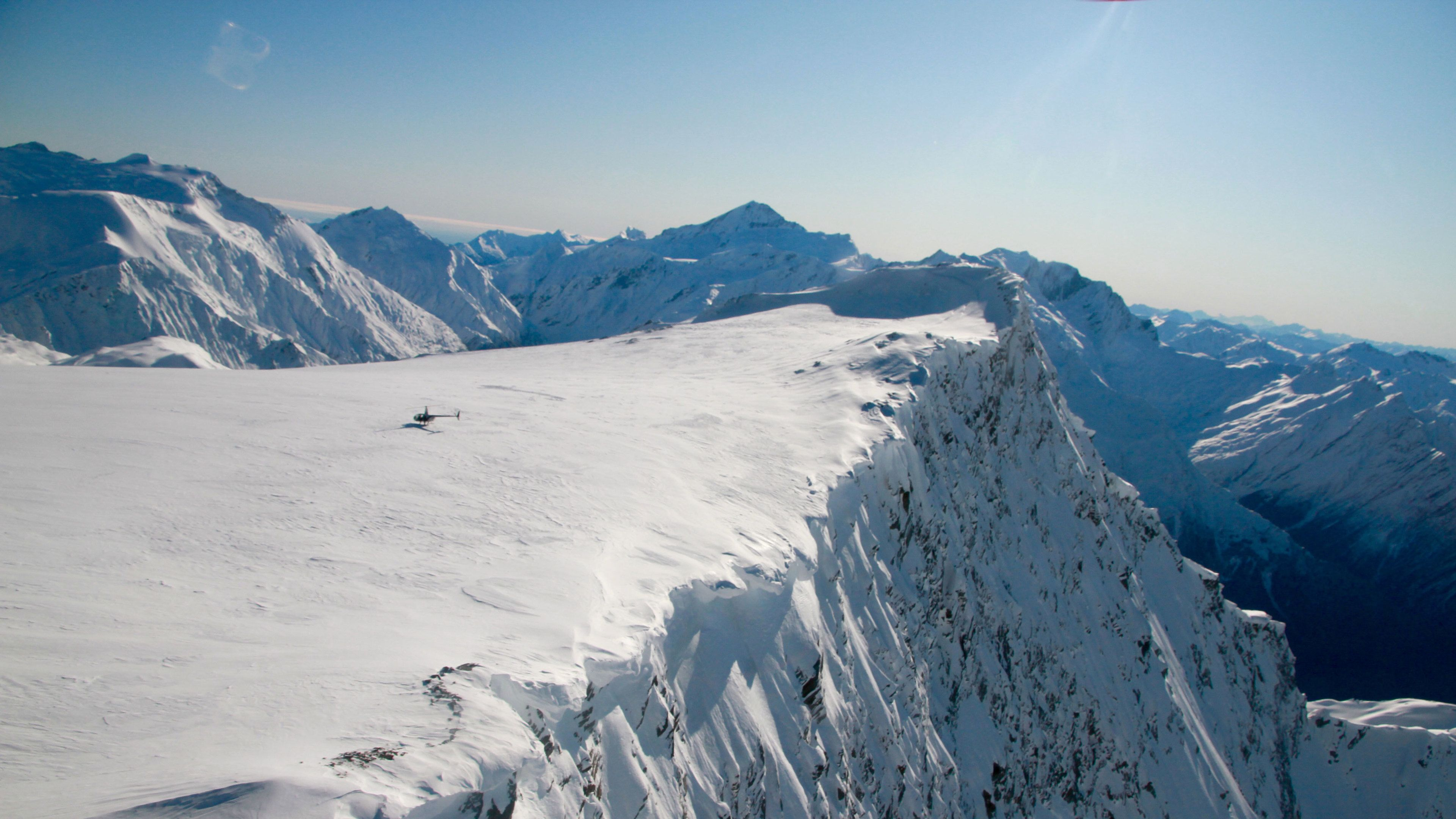 Aerial view of Helicopter on snowy mountain top