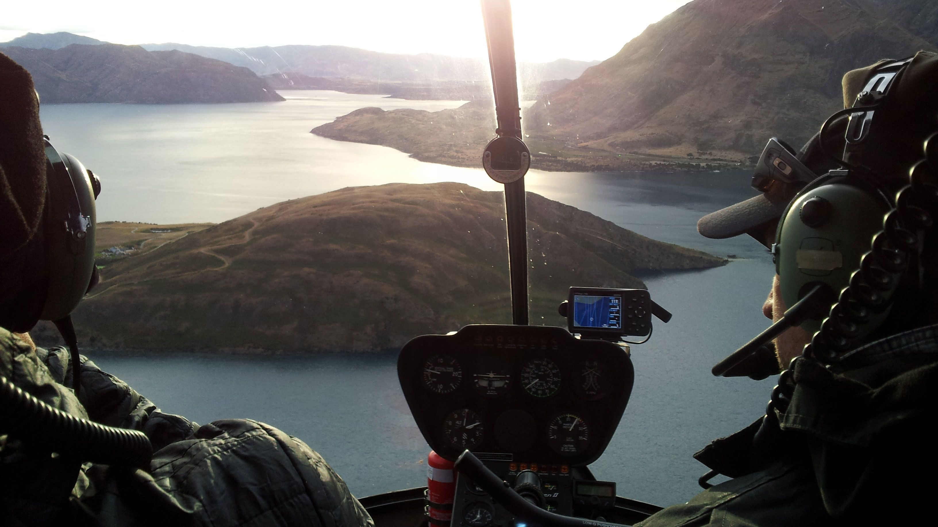 View of fjords from a Helicopter cockpit