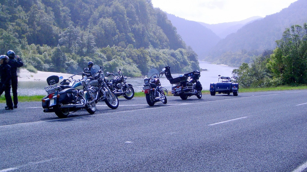 Show item 3 of 5. Motorcycles pulled over at vista in New Zealand