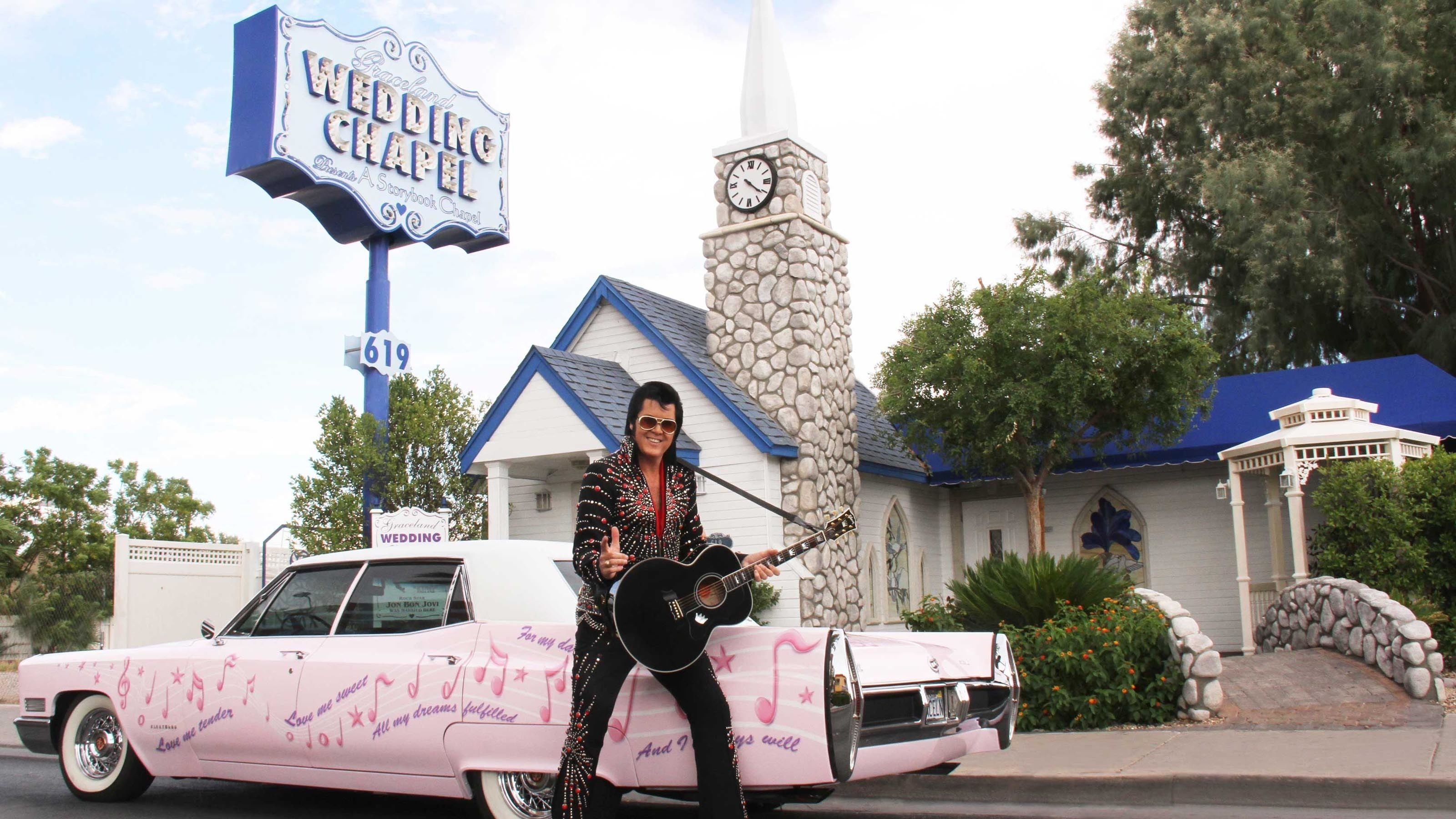 Elvis awaiting the arrival of the bride and groom to the wedding chapel