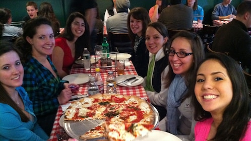 Group of people at a pizzeria in New York