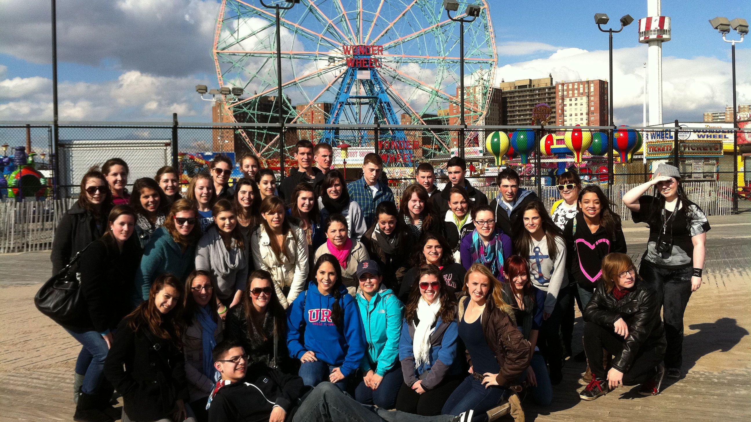 Tour group at Coney Island amusement park in New York