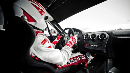 Behind the wheel of a Ferrari race car on the Las Vegas Motor Speedway
