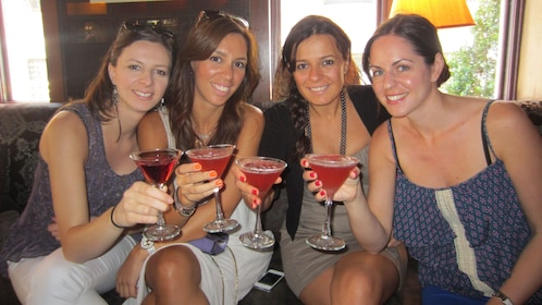 Four women with cosmos in New York