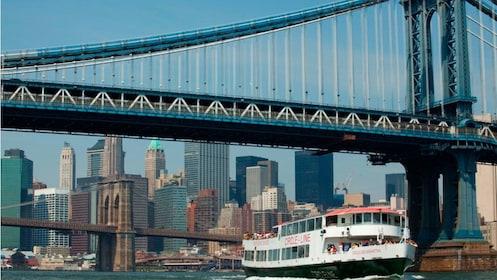 Cruise boat going under the Manhattan Bridge in New York