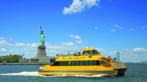 New York Water Taxi going past the Statue of Liberty