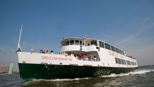 Sightseeing boat with passengers on the water in New York