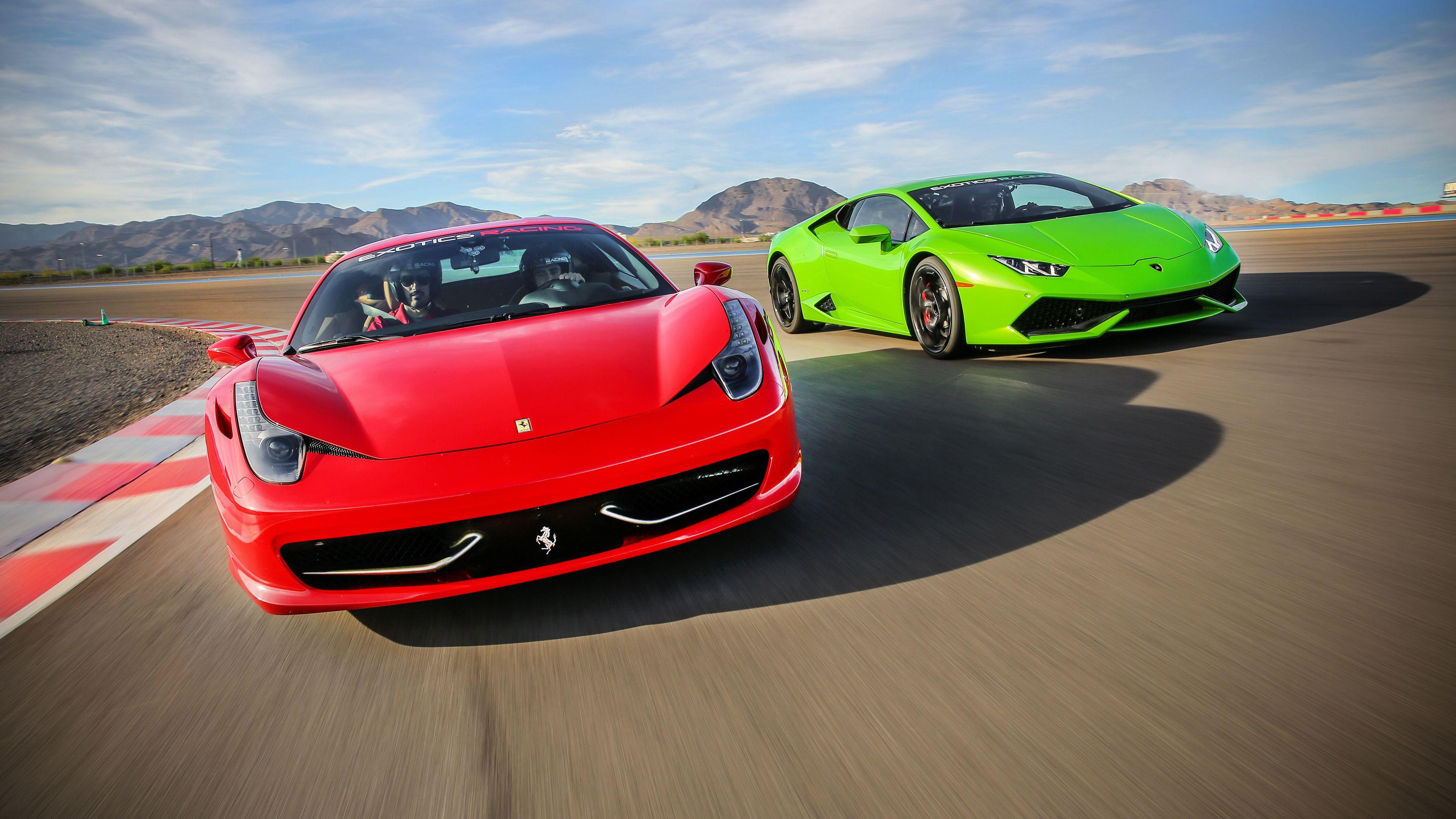 Ferrari Italia and Lamborghini Huracan race around the exotics racing course